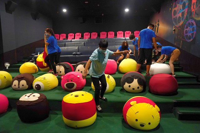 Staff members put covers on beanbags for kids at ACE cinema ahead of its reopening, following the coronavirus outbreak, in Beijing, China on July 28, 2020. (Photo by Tingshu Wang/Reuters)