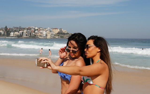 Friends take a selfie as they enjoy the warm weather down at Bondi Beach on October 31, 2014 in Sydney, Australia.  Australia is expecting much hotter temperatures than usual for the next three months. (Photo by Daniel Munoz/Getty Images)