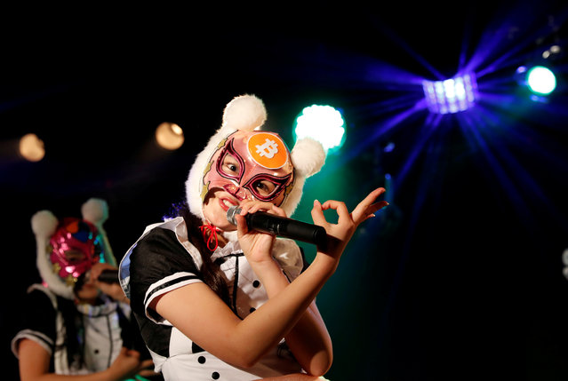 "Members of Japan's idol group ""Virtual Currency Girls"" wearing cryptocurrency-themed masks perform in their debut stage event in Tokyo, Japan, January 12, 2018. The Japanese pop group hopped on the bitcoin bandwagon on Friday, dedicating themselves to singing and dancing about the cryptocurrencies that have taken the world by storm, and especially their homeland. (Photo by Kim Kyung-Hoon/Reuters)"