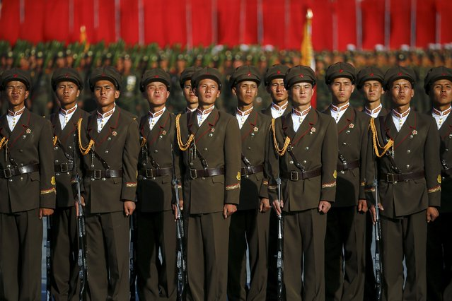Soldiers listen to North Korean leader Kim Jong Un addressing the parade celebrating the 70th anniversary of the founding of the ruling Workers' Party of Korea, in Pyongyang October 10, 2015. (Photo by Damir Sagolj/Reuters)