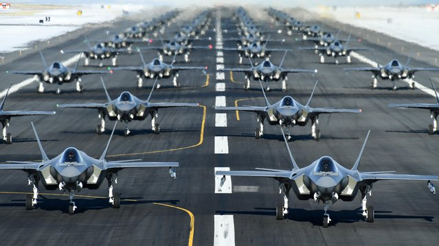"""U.S. Air Force F-35A aircraft, from the 388th and 428th Fighter Wings, form up in an """"elephant walk"""" during an exercise at Hill Air Force Base, Utah. U.S. on January 6, 2020. (Photo by R. Nial Bradshaw/Air Force via Reuters)"""
