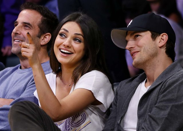 Mila Kunis and actor Ashton Kutcher sit courtside at the  Lakers – Suns game at the Staples Center in Los Angeles, February 12, 2013. (Photo by Danny Moloshok/Associated Press)