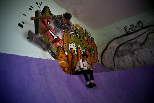 In this January 11, 2018 photo, a skater practices inside an abandoned gym that was converted into a recreational space for skateboarders, the day of its inauguration inside the Educational complex Ciudad Libertad, a former military barracks that the late Fidel Castro turned into a school complex after the revolution in Havana, Cuba. The park is getting daily use, and a national convention of Cuban skateboarders is planned for June. (Photo by Ramon Espinosa/AP Photo)