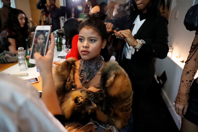 A model gets ready backstage before the #MeToo Fashion show during New York Fashion Week in New York, USA on February 9, 2018. (Photo by Elizabeth Shafiroff/Reuters)