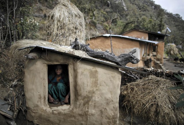 Uttara Saud, 14, sits inside a Chaupadi shed in the hills of Legudsen village in Achham District in western Nepal in this February 16, 2014 file picture. Chaupadi is the practice of treating women as impure and untouchable when they menstruate. In isolated regions like Achham, chaupadi has been a custom for centuries. But those from Nepal's cities or from abroad often don't know what it means. (Photo and caption by Navesh Chitrakar/Reuters)