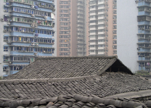 "Traditional ""dragon scale"" tiled rooftops can still be found in Chongqing, the most industrialized city in western China. (Photo by Tom Carter/The Atlantic)"