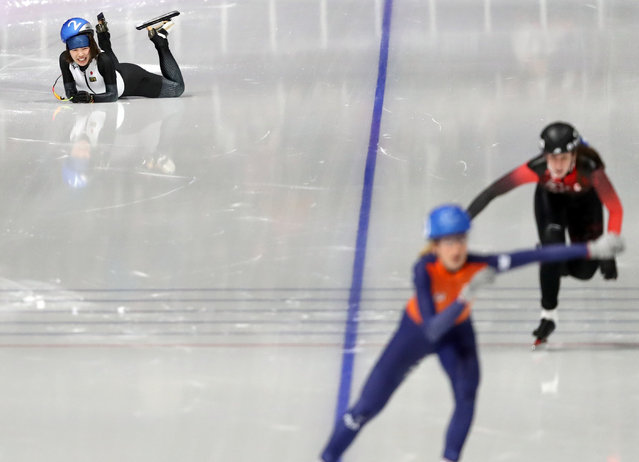 Ayano Sato of Japan reacts after the fall during the women' s mass start semifinal speedskating race at the Gangneung Oval at the 2018 Winter Olympics in Gangneung, South Korea, Saturday, February 24, 2018. (Photo by Lucy Nicholson/Reuters)