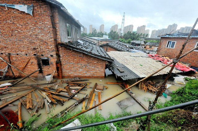 Houses are submerged in floodwaters brought by typhoon Megi in Ningde, eastern China's Fujian province on September 28, 2016. (Photo by AFP Photo/Stringer)
