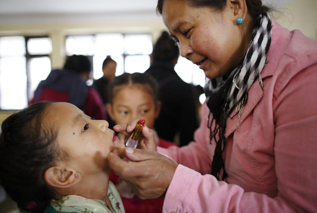 A Tibetan girl is gets makeup done for a function organised by the Tibetan Refugee Community in Nepal, commemorating the 25th Anniversary of the Nobel Peace Prize conferment to exiled Tibetan spiritual leader Dalai Lama and the 66th International Human Rights Day in Kathmandu December 10, 2014. (Photo by Navesh Chitrakar/Reuters)