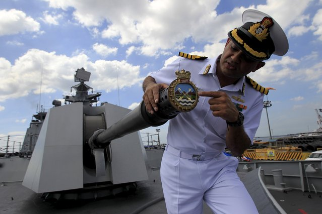 """Kunal Rajkumar, an Indian navy commanding officer, explains the meaning of the seal on a turret during a briefing with the media onboard the Indian naval ship """"INS Sahyadri"""" docked at north harbor in Manila November 3, 2015. The """"INS Sahyadri"""" is a Shivalik Class warship that was inducted into the Indian Navy on July 2012, with a multi-role stealth frigate and boasting an array of weaponry in its arsenal, according to the Indian navy. (Photo by Romeo Ranoco/Reuters)"""