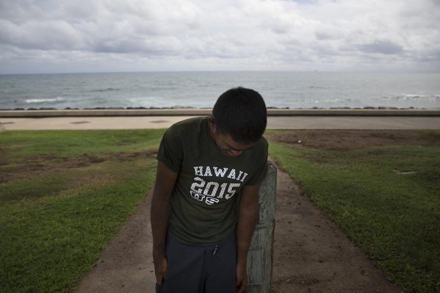 In this Monday, August 24, 2015 photo, Foster Waynewright, 28-year-old homeless man, leans on a post while resting in Kakaako Waterfront Park in Honolulu. Waynewright lives in a minivan with his grandmother. Homelessness in Hawaii has grown in recent years, leaving the state with 487 homeless per 100,000 people, the nation's highest rate per capita, ahead of New York and Nevada, according to federal statistics. (Photo by Jae C. Hong/AP Photo)