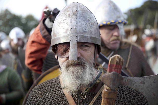 A re-enactor poses for a portrait before a re-enactment of the Battle of Hastings, commemorating the 950th anniversary of the battle, in Battle, Britain October 15, 2016. (Photo by Neil Hall/Reuters)