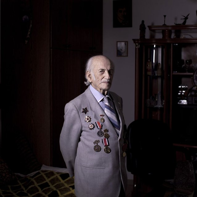 In this photo made Friday, April 12, 2013, Soviet Jewish World War Two veteran Semion Tzvang 89, poses for a portrait at his house in the southern Israeli city of Ashkelon. Tzvang joined the Red Army in 1941 and served in the First Ukrainian Front, a Soviet army group. He fought in Kiev, Prague and Berlin. Tzvang immigrated to Israel in 1991. About 500,000 Soviet Jews served in the Red Army during World War Two, and the majority of those still alive today live in Israel. (Photo by Oded Balilty/AP Photo)
