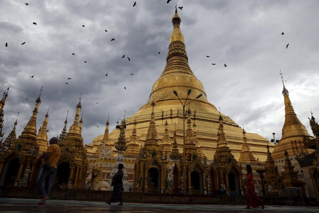 People walk around Shwedagon Pagoda in Yangon, Myanmar, November 10, 2015. (Photo by Jorge Silva/Reuters)