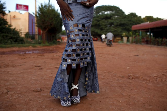 Model Sira Coulibaly poses for a picture in a bazin dress made by designer Mariah Bocoum Keita in Bamako, Mali, October 21, 2015. (Photo by Joe Penney/Reuters)