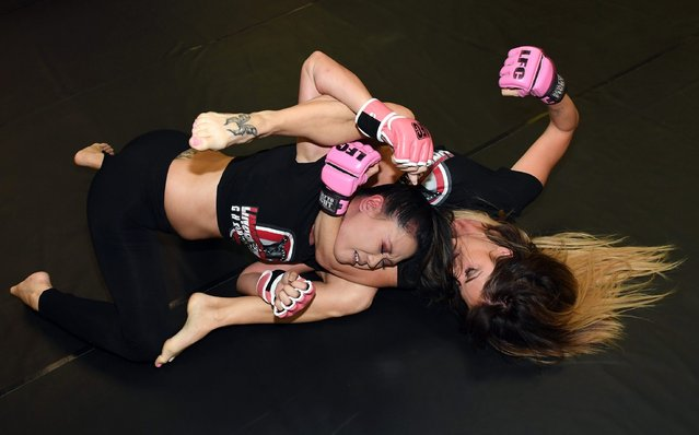 "Fighters Holly ""The Lotus"" Mei (L) and Teri ""Feisty Fists"" London train for the upcoming 'Lingerie Fighting Championships 22: Costume Brawl I' at DXG Self Defense on October 25, 2016 in Las Vegas, Nevada. The event is scheduled to feature eight bouts at 4 Bears Casino & Lodge on October 29, 2016 in New Town, North Dakota. (Photo by Ethan Miller/Getty Images)"