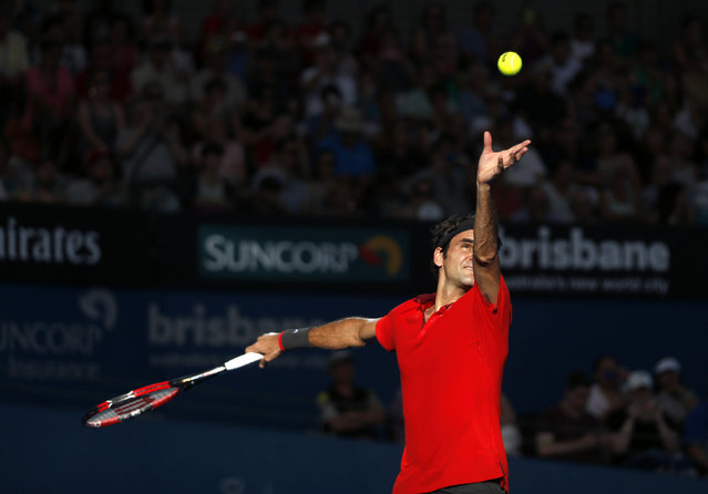Roger Federer of Switzerland serves during his men's singles semi final win over Grigor Dimitrov of Bulgaria at the Brisbane International tennis tournament in Brisbane, January 10, 2015. (Photo by Jason Reed/Reuters)