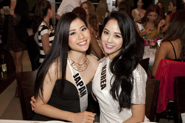 Miss Japan 2014 Keiko Tsuji and Miss Korea 2014 Yoo Ye-bin pose for photos at Harvest Delight Restaurant in Miami in this January 10, 2015 picture provided by the Miss Universe Organization. (Photo by Reuters/Miss Universe Organization)