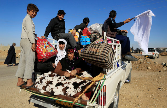People who just fled Kokjali near Mosul are seen along the road east of Mosul, Iraq November 3, 2016. (Photo by Zohra Bensemra/Reuters)