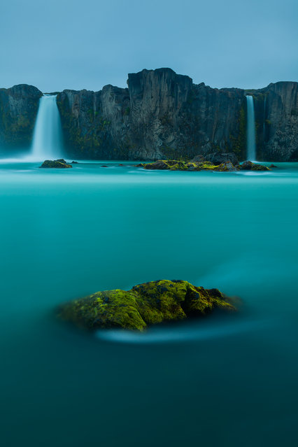 """Waterfall of Gods"". I wanted to synthesize all the power of the waterfall of the gods in a soft and to transmit all the calmness with which I would have liked to see the scene. Illumination light from the midnight sun at 01:00 am. Location: Godafoss, north Iceland. (Photo and caption by Pere Soler Isern/National Geographic Traveler Photo Contest)"