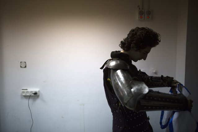 """An Israeli competitor is seen at the dressing room during the """"World Medieval Fighting Championship – the Israeli Challenge"""" in Rishon Letzion near Tel Aviv on January 22, 2015. (Photo by Amir Cohen/Reuters)"""