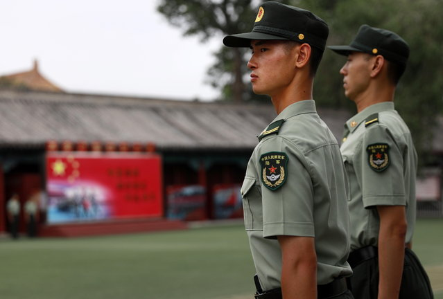 Chinese People's Liberation Army (PLA) solders stand guard inside the grounds of the Forbidden City across Tiananmen Square on the eve of the 29th anniversary of the 1989 June 4th Tiananmen Square protests in Beijing, China, 03 June 2018. This year 04 June 2018 marks the 29th anniversary of the Tiananmen Square protests of 1989. Tourists continue to throng the site on the eve of the anniversary of the violent crackdown of the student protests in 1989 but foreign journalists were not allowed to enter the square. (Photo by How Hwee Young/EPA/EFE)