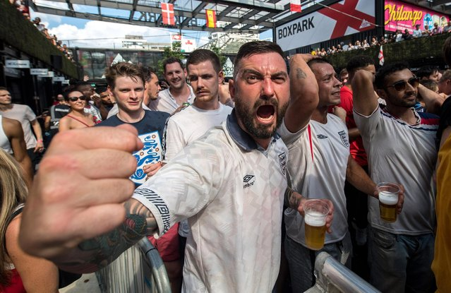 England football fans celebrate after England score their second goal in the England V Sweden quater final match in the FIFA 2018 World Cup Finals at Croydon Boxpark on July 7, 2018 in London, England. World Cup fever is building among England fans after reaching the quater finals in Russia. (Photo by Chris J. Ratcliffe/Getty Images)