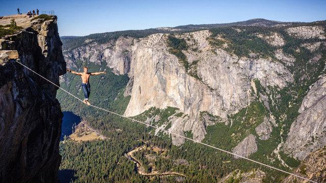 Photographer: Alexandre Buisse. Athlete: Mich Kemeter. Location: Taft Point, Yosemite, California. (Photo by Alexandre Buisse/Red Bull Illume via The Atlantic)