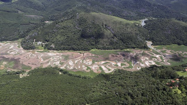 An aerial view of the Atibainha dam, part of the Cantareira reservoir, is seen during a drought in Nazare Paulista, Sao Paulo state February 12, 2015. (Photo by Paulo Whitaker/Reuters)