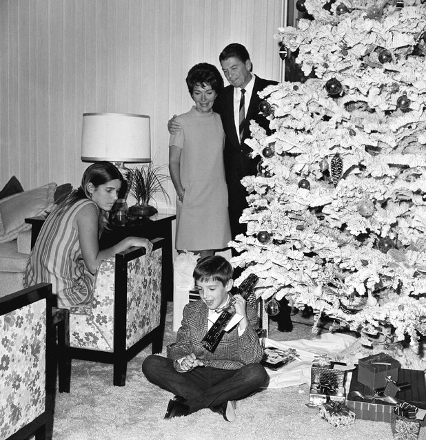 Gov. Ronald Reagan and wife Nancy are joined by Ronnie Jr., 9, and Patty, 15, as they looked over the Christmas tree and presents at the Reagans' Pacific Palisades home, near Los Angeles, on December 22, 1967. (Photo by Harold Filan/AP Photo)