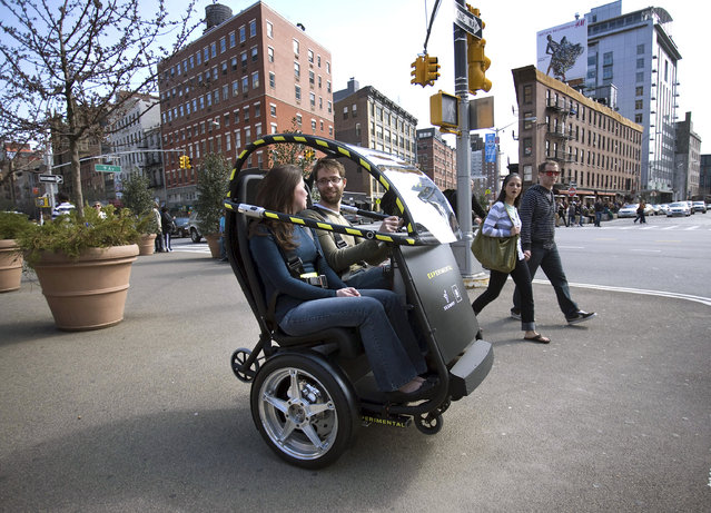 The Project P.U.M.A. prototype is shown during a test drive in Brooklyn, New York April 4, 2009. General Motors and Segway are developing an electric two-seat prototype vehicle with just two wheels, which could allow people to travel around cities more quickly, safely, quietly and cleanly, and at a lower total cost. The collaboration, dubbed Project P.U.M.A. (Photo by Reuters/Emile Wamsteker-General Motors)