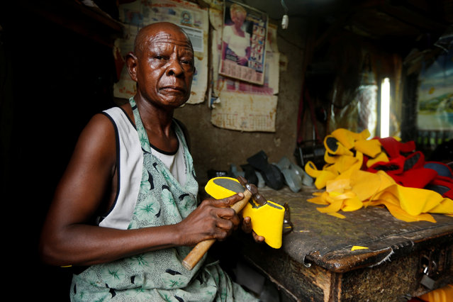 A shoemaker works in Ariaria market in Aba, Nigeria August 19, 2016. (Photo by Afolabi Sotunde/Reuters)