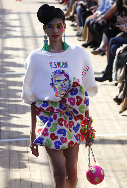 A model wears a creation printed with Brazilian soccer player Thiago Silva's face, for Manish Arora's Spring/Summer 2019 ready-to-wear fashion collection presented in Paris, Thursday, September 27, 2018. (Photo by Christophe Ena/AP Photo)