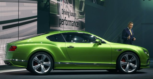 Bentley CEO Wolfgang Durheimer speaks next to the new Continental GT Speed during a Volkswagen Group event ahead of the 85th International Motor Show in Geneva, March 2, 2015.                   REUTERS/Arnd Wiegmann (SWITZERLAND  - Tags: TRANSPORT BUSINESS)