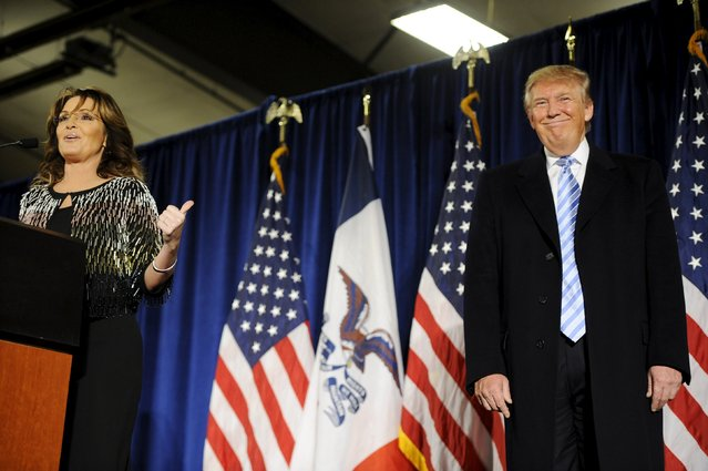 Former Alaska Gov. Sarah Palin (L) points to U.S. Republican presidential candidate Donald Trump (R) as she speaks after endorsing him for President at a rally at Iowa State University in Ames, Iowa January 19, 2016. (Photo by Mark Kauzlarich/Reuters)
