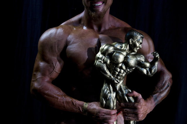 In this Thursday, October 18, 2018 photo, Or Magdasi of Tel Aviv, holds his trophy after winning the National Amateur Body Builders' Association competition in the mens category, in Tel Aviv, Israel. Magdasi will have a shot at representing Israel at the 2019 Mr. Universe competition in the United Kingdom. (Photo by Oded Balilty/AP Photo)