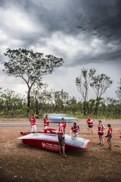 A handout image of the Red Engine Team obtained on 04 October 2013 shows Dutch Red Engine solar car team test drives their vehicle in the Northern Territory, Australia, 21 September 2013. The Dutch vehicle is competing in the World Solar Challenge, driving from Darwin to Adelaide starting on 06 October 2013. (Photo by Joost Van Baars/EPA/Red Engine Team)