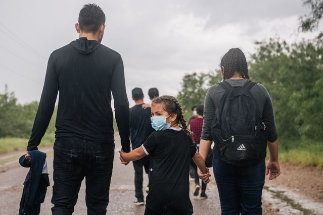Immigrants seeking asylum walk towards border patrol after crossing into the U.S. on June 16, 2021 in La Joya, Texas. A surge of mostly Central American immigrants crossing into the United States has challenged U.S. immigration agencies along the U.S. Southern border. (Photo by Brandon Bell/Getty Images)