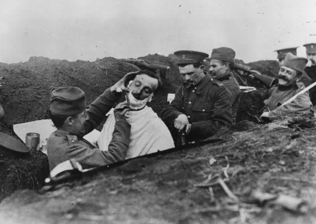 A soldier gets a shave in a Serbian trench, circa 1916.  (Photo by Hulton Archive/Getty Images)