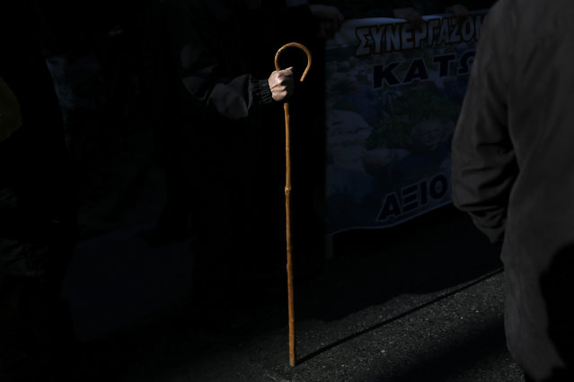 GREECE: A Greek pensioner holds a shepherd's crook during a demonstration against planned pension reforms in Athens, Greece, January 19, 2016. (Photo by Alkis Konstantinidis/Reuters)