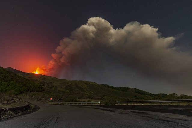 Smoke billows from the southern side crater of Mt. Etna, Europe's largest active volcano, near Catania, southern Italy Sicily, early Tuesday, May 24, 2021. (Photo by Salvatore Allegra/AP Photo)