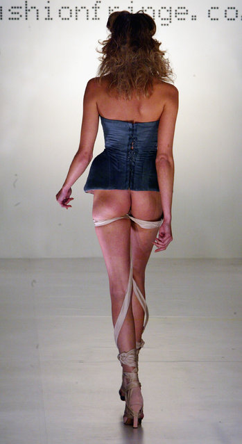 A model walks down the runway at the Rubecksen Yamanaka show during the Fashion Fringe show as part of London Fashion Week Spring/Summer 2005 at Selfridges car park, 400 Oxford Street on September 22, 2004 in London. (Photo by Dave Hogan/Getty Images)
