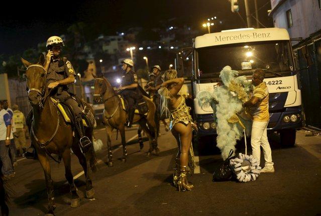 Revellers of the Estacio de Sa samba school leave the Sambadrome after parading in the carnival in Rio de Janeiro, February 7, 2016. (Photo by Ricardo Moraes/Reuters)