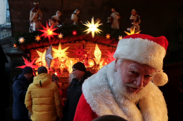 A man dressed as Santa Claus is pictured at the Christmas market near the Frauenkirche (Church of Our Lady) in Dresden, Germany, December 9, 2018. (Photo by Fabrizio Bensch/Reuters)