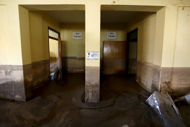 A view of muddy bathrooms in a flooded warehouse in Los Loros town April 7, 2015. (Photo by Ivan Alvarado/Reuters)