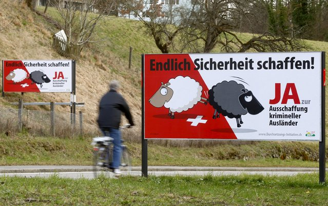 """Posters of Swiss People's Party (SVP) demanding to deport criminal foreigners are displayed beside a road in Adliswil, Switzerland February 11, 2016. Switzerland will hold a binding referendum later this month on whether to subject any foreign resident to automatic deportation if convicted of offences running the gamut from murder to breaking the speed limit. The posters read, """"At last make things safer! Say yes to deportation of criminal foreigners"""". (Photo by Arnd Wiegmann/Reuters)"""