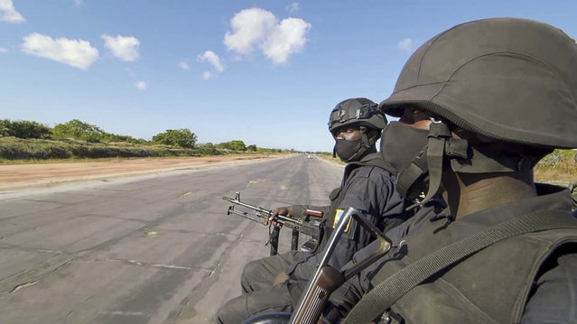 In this image made from video, Rwandan troops travel by road near the airstrip in Afungi, Cabo Delgado province, Mozambique Saturday, August 7, 2021. A joint force of Mozambican and Rwandan troops has regained control of the strategic port of Mocimboa da Praia from Islamic extremists who held the town in northern Mozambique for a year, the countries' defense ministries have announced. (Photo by Marc Hoogsteyns/AP Photo)