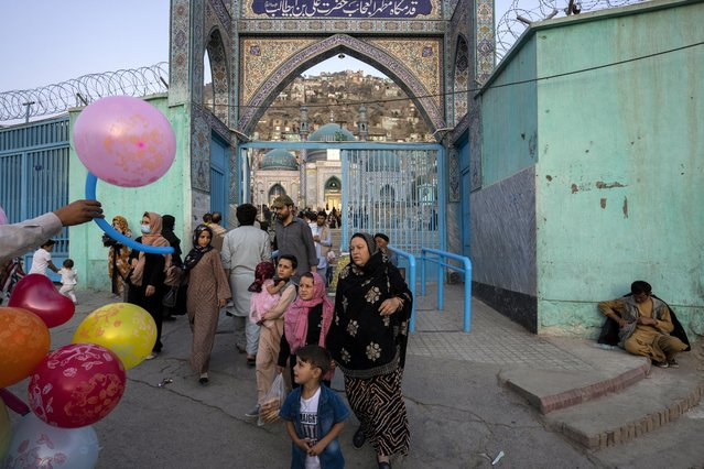 Families walk out of the Sakhi Shrine in Kabul, Afghanistan, Friday, September 10, 2021. (Photo by Bernat Armangue/AP Photo)