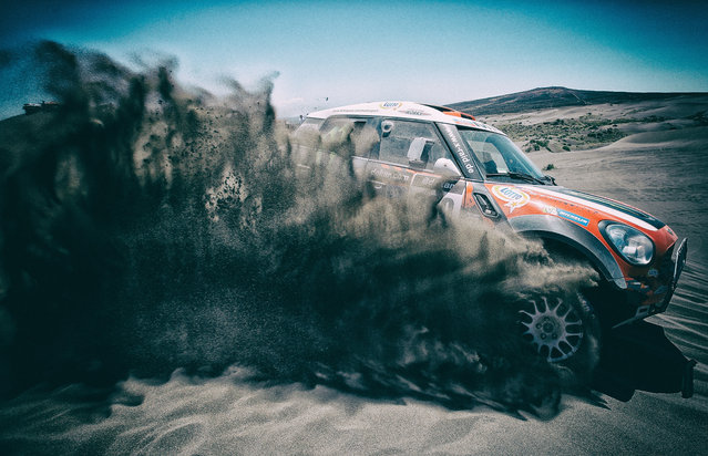 (#309) Krzysztof Holowczyc and Konstantin Zhiltsov of Poland in the MINI for Monster Energy X-Raid Team competes on Day 2 of the Dakar Rally 2014 on January 6, 2014 in the Dunes of Nihuil, Argentina. (Photo by Dean Mouhtaropoulos/Getty Images)