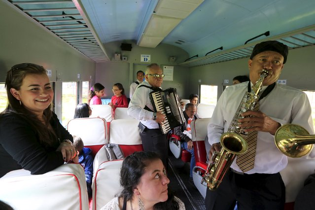 "Colombian musicians perform in a ""La Sabana"" tourist train car in Bogota March 1, 2015. (Photo by Jose Miguel Gomez/Reuters)"